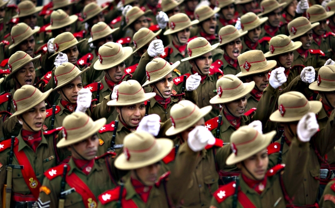 Indian soldiers practice a march ahead of Republic Day parade in
